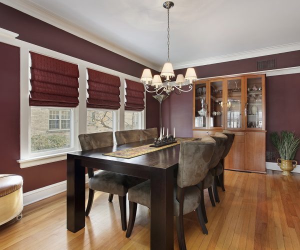 10537549 - dining room with maroon walls and three windows